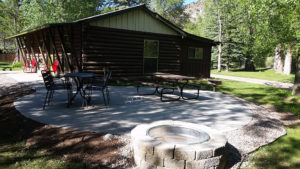 cabin-exterior-with-fire-pit-chairs-300x169.jpg